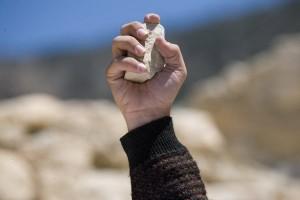 stoning-hand