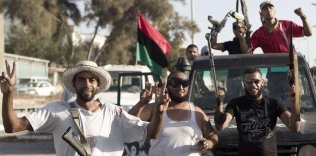 Des rebelles dans Tripoli, en Libye, en août 2011.