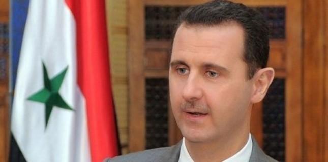 Photo transmise par l'agence de presse syrienne Sana du président syrien Bachar al-Assad lors d'une émission télévisée à Damas le 30 octobre 2011 © Afp