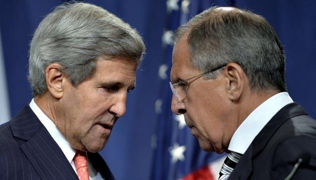 John Kerry, le secrétaire d'Etat américain et son homologue russe Sergei Lavrov lors d'une conférence de presse à Genève, le 14 septembre 2013.