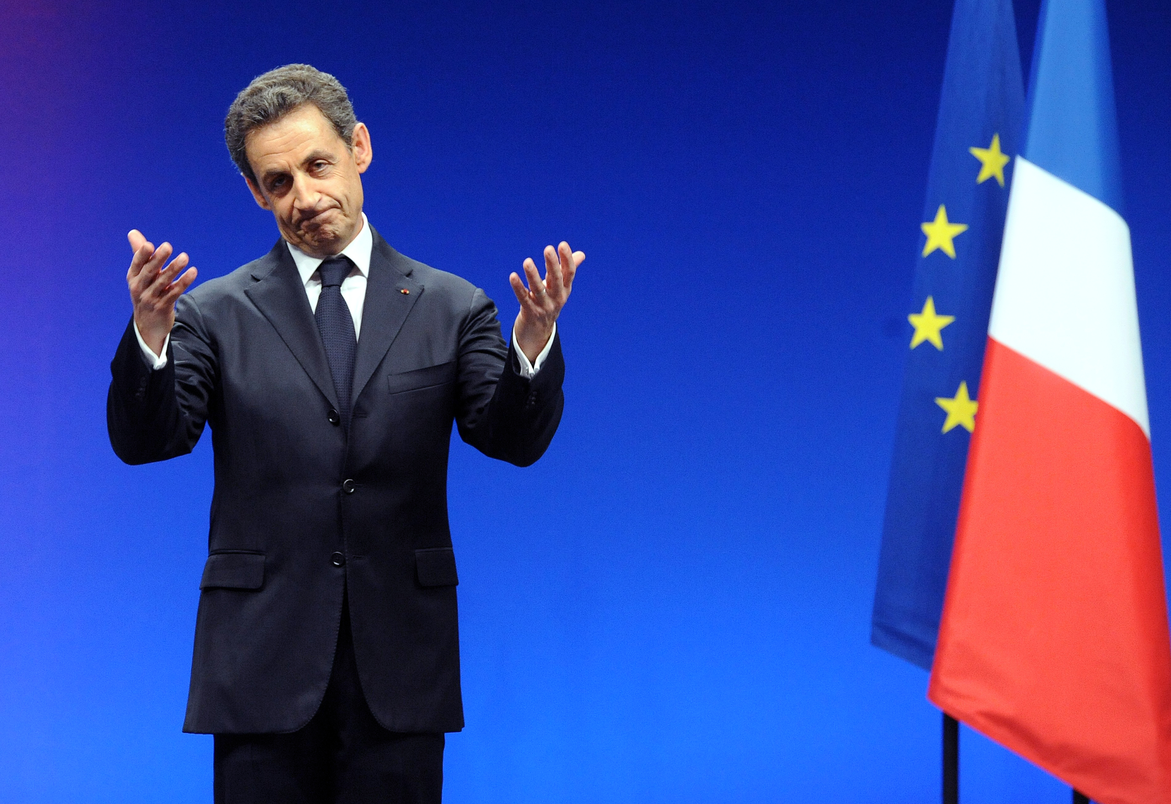 (FILES)-- A file photo taken on February 28, 2012 shows France's President at the time and Union for a Popular Movement (UMP) party candidate for 2012 presidential election Nicolas Sarkozy gesturing to the crowd at the end of a campaign meeting  in Montpellier, southeastern France. The Paris prosecutor's office, in a statement released on July 29, 2014, denied having recently opened an investigation into the financing of the 2007 presidential campaign of Nicolas Sarkozy. AFP PHOTO / PASCAL GUYOT