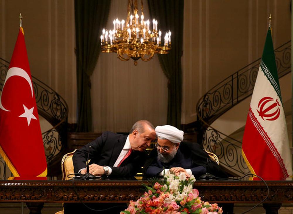 Le président de la Turquie, Recep Tayyip Erdogan, à gauche, et le président iranien Hassan Rouhani.
