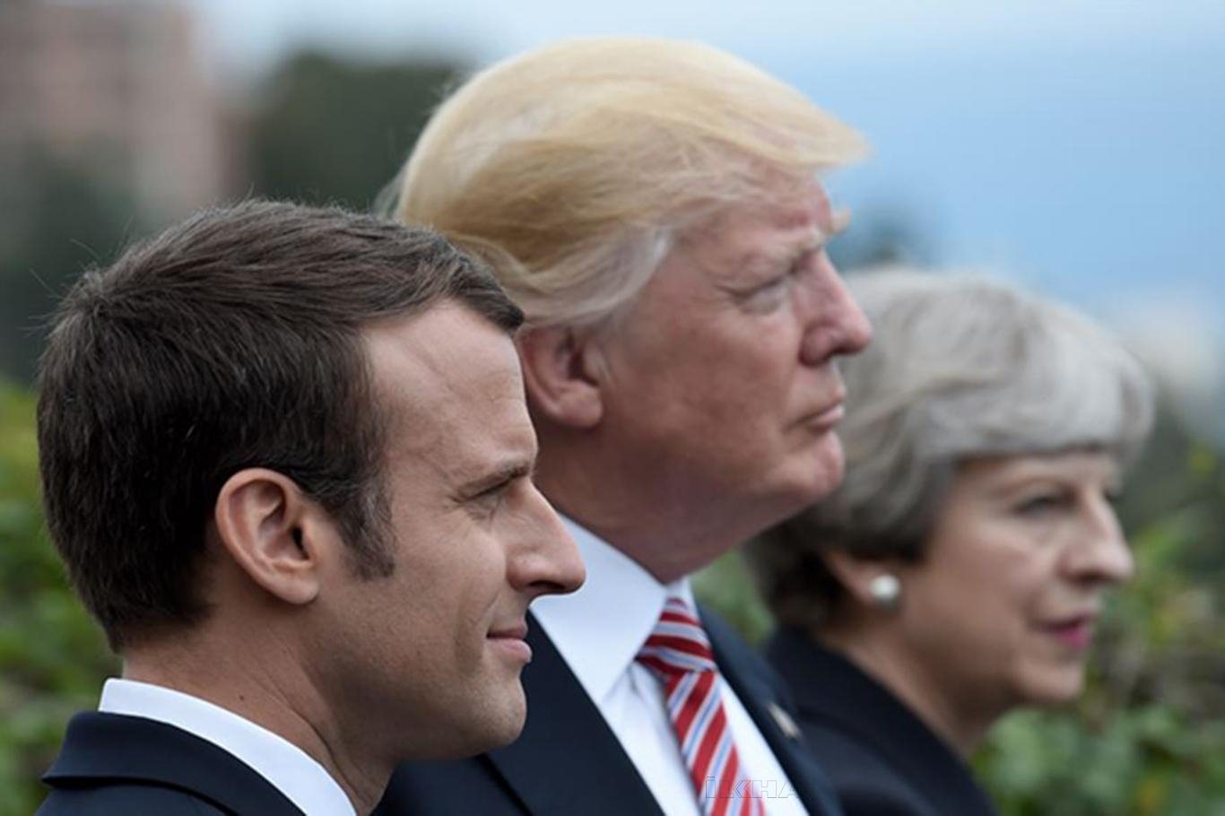 Emmanuel Macron, Donald Trump, Theresa May.