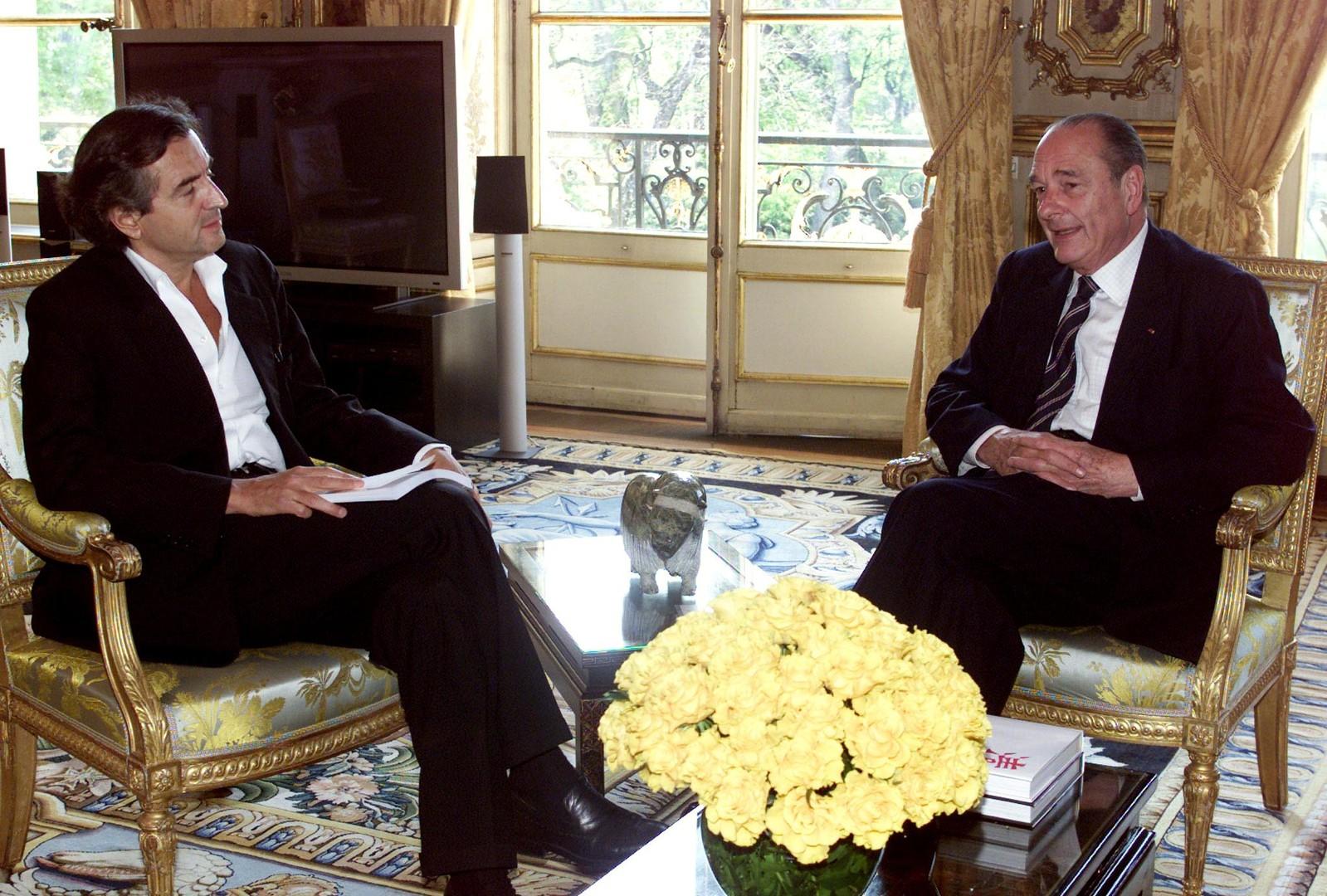 Bernard-Henri Lévy et Jacques Chirac à l'Elysée le 3 avril 2002.